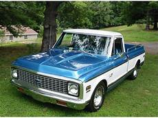 1971 chevy truck medium blue looks like a c10 also looks like some metallic was added to the