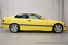 dakar yellow bmw e36 m3 with low cars for