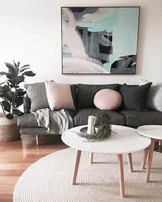 living room grey lounge pink cushions artwork