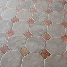 limestone octagon flooring with terra cotta cabochons