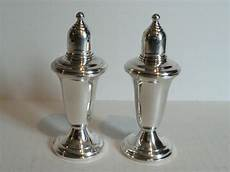 salt and silver pair empire sterling silver glass lined salt pepper
