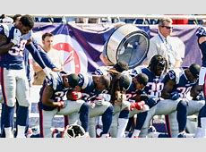 why are football players kneeling
