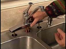 changing kitchen sink faucet how to replace a kitchen faucet
