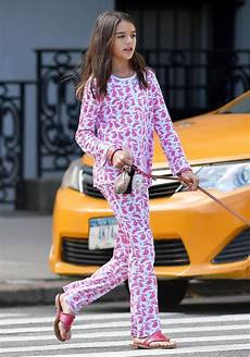 suri cruise wears cute rabbit printed outfit while walking dog
