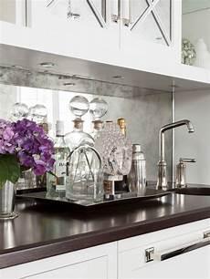 antiqued mirrored backsplash transitional kitchen