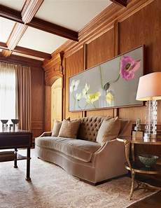 inviting living room with wood paneling wall warm color