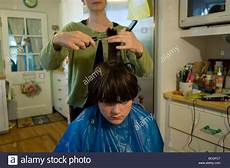 a gets his hair cut at his home in lincoln ne 24883719 alamy