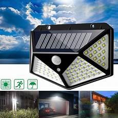 100 led solar powered pir motion sensor wall light outdoor