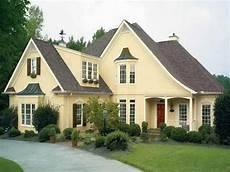 brown roof med yellow brick trim and door and fences house paint exterior