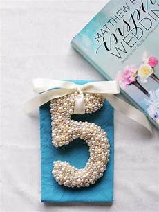 diy pearled number can be used as table numbers cake