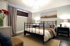 Basement Bedroom Ideas No Windows by Serene Basement Bedroom With Elongating Curtains Hgtv