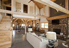 open floor plan in a barn home with loft living space wood post beams add style www
