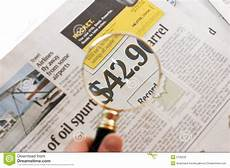 newspaper price magnified 2 stock photography image 5735232