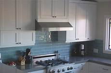 light blue subway tile as the backsplash to contrast the