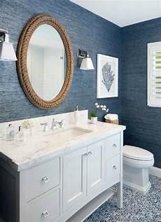 seaside bathroom ideas an oval mirror gives the linear bathroom a hint of satin nickel light fixtures
