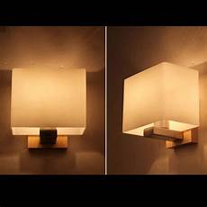 contemporary akili white and timber cube wall light buy lights
