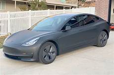 tesla model 3 black matte black tesla model 3 stunning photos wrap cost and info