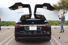 tesla model y doors tesla model y tesla transit tesla gigafactories more
