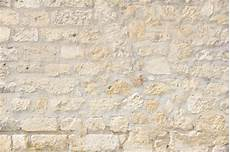 uneven brick wall in light colors photo free download