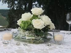 composizioni candele e fiori matrimonio centrotavola con bianche in vaso di vetro