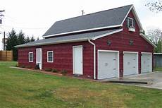 3 car red barn style garage