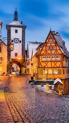 winter germany iphone wallpaper germany rothenburg town evening lights snow
