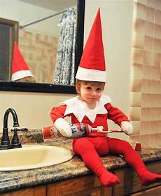 dad turns baby into elf the shelf doll pics