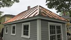 shed with copper standing seam metal roof fab and