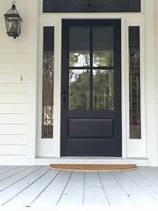 farmhouse front door classic 4 pane door painted black front door light gray a painted porch