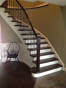 wrought iron spindles white risers dark maple steps