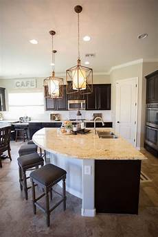 the unique curved kitchen island provides extra casual seating in the kitchen and also gives the