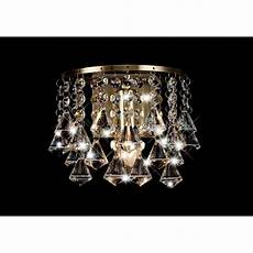 deco acton single light switched prism crystal wall fitting in antique brass finish castlegate