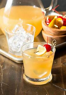 meyer lemon whiskey sours garnish with lemon
