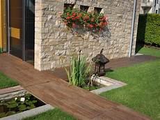 pedana legno giardino giardino con vasca d acqua progettazione giardini