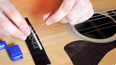 how to replace guitar strings how to change an acoustic guitar string easy