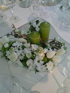 composizioni candele e fiori centrotavola su specchio con candele nel 2019