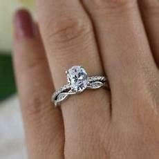 1 25 ct oval diamond swirl halo bridal wedding ring