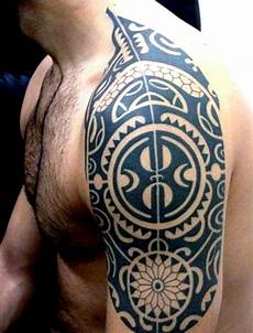 Oberarm Tribal - top 60 best tribal tattoos for symbols of courage