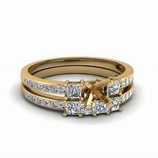 delicate 3 stone emerald cut diamond bridal with ruby