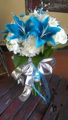 blue and white wedding bouquet blue silver white sparkley carnations stock lilies