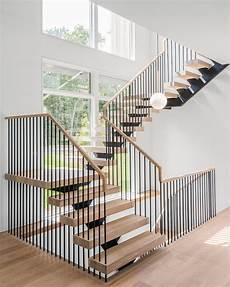 steel spindle railing floating stairs htons ny keuka studios