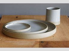 grey dinnerware set. 3 plates and 1 cup table setting