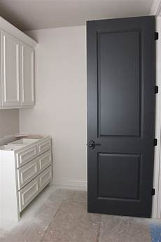 door color is wrought iron by benjamin trim paint color westhighland white by sherwin