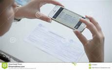 using phone to take picture of receipt or bill online paying bills from comfort of