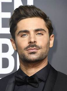 zac efron s dreadlocks triggers outrage on social media