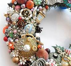 wreath loaded with vintage jewelry