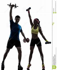 fitness male and female woman exercising fitness workout with man coach stock