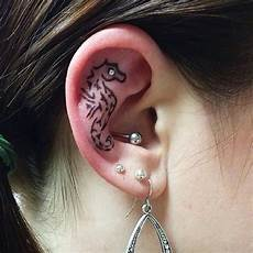 58 creative ear tattoos that would make mike tyson hungry