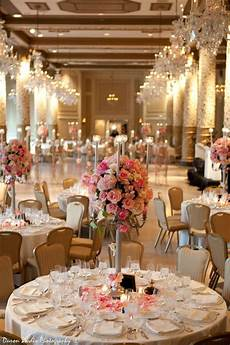 glamorous gold reception with tall floral centerpieces wedding gold reception tablescape