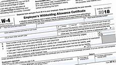 how and why to adjust your irs tax withholding bankrate com